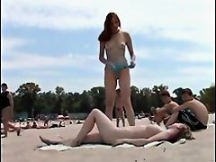 Two incredibly hot teen babes are enjoying on a nudist beach and they get filmed in this voyeur beach nudism video. They look very pretty and ideal fo