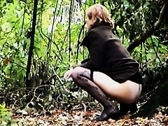 Amateur loses down pantyhose in wood on pissing voyeur video