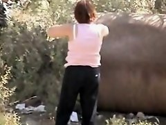 Brunette mature pissing outdoor spied from behind