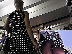 Upskirt cam caught sexy lady in short polka dot skirt